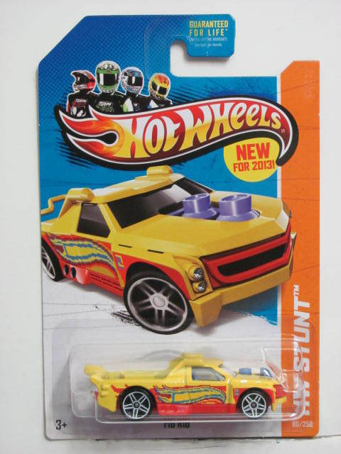 HOT WHEELS 2013 HW OFF-ROAD STUNT CIRCUIT FIG RIG YELLOW