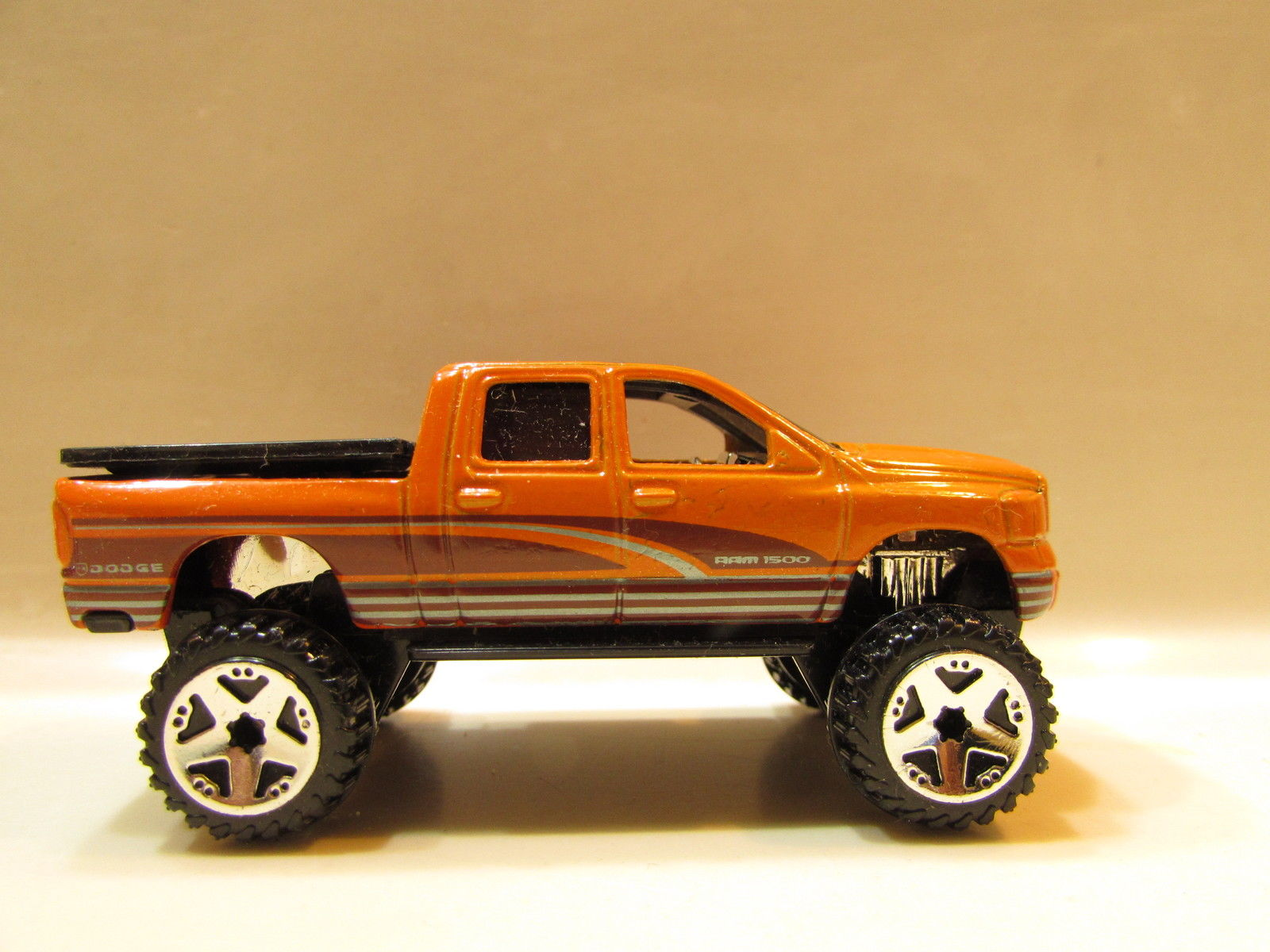 HOT WHEELS 2009 DODGE RAM 1500 ORANGE LOOSE